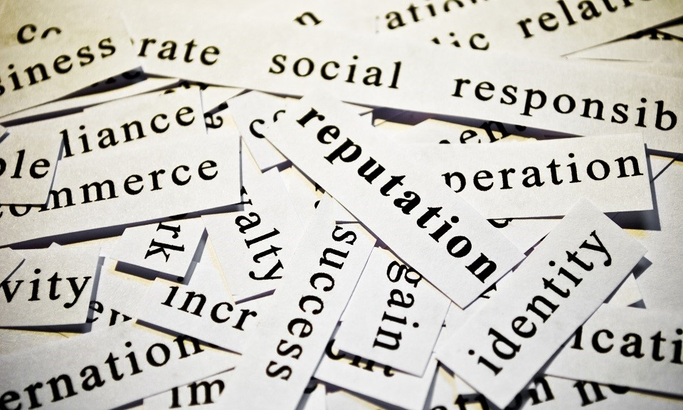 Reputation. Concept of cutout words related with business.