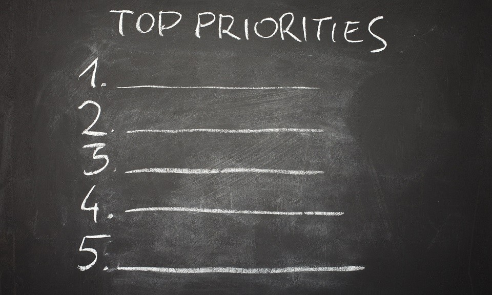 Blank list of life priorities on a blackboard, to be filled out: metaphor of a personal agenda of things to do in life,