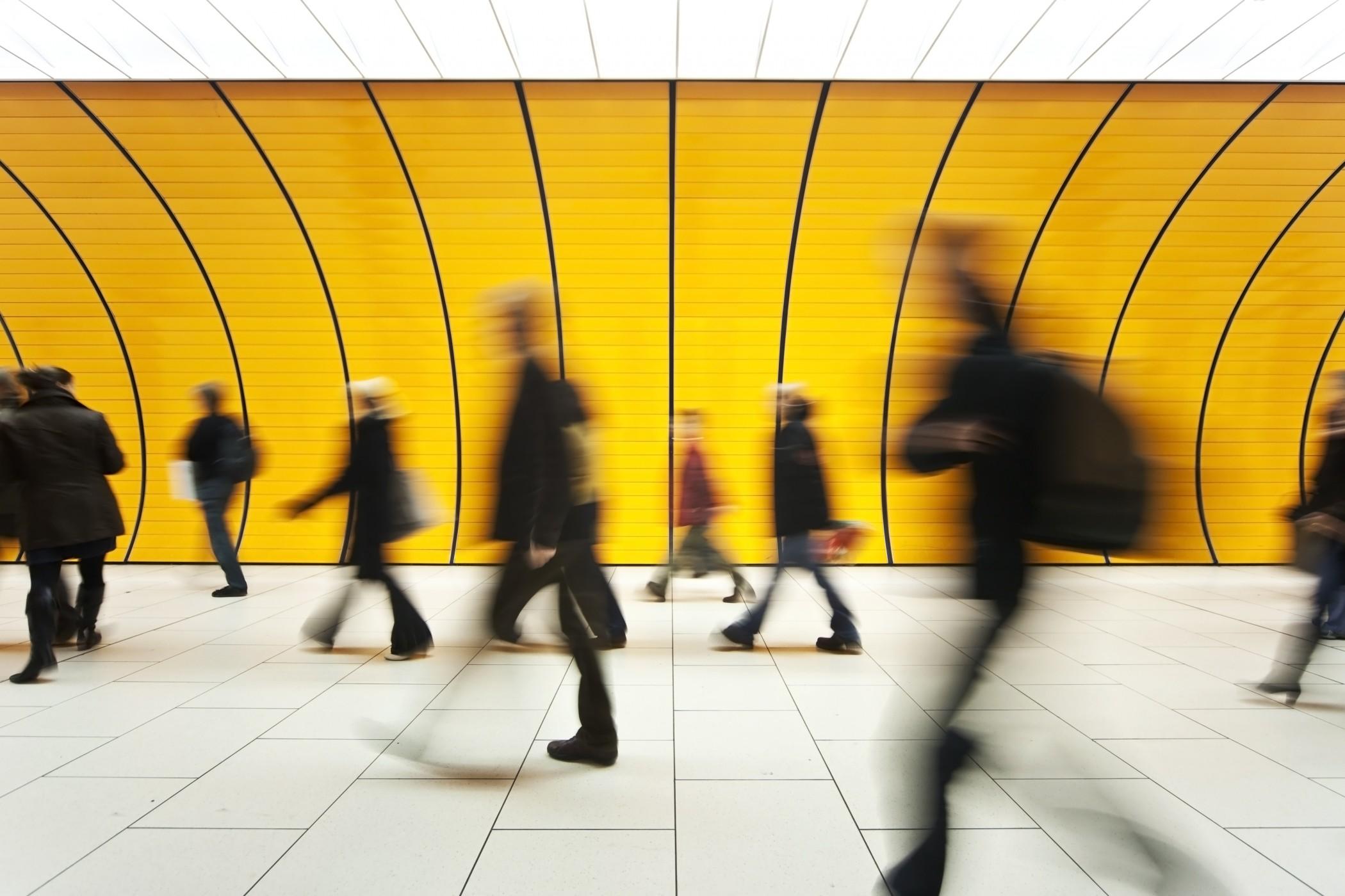 blurred and defocused people walking