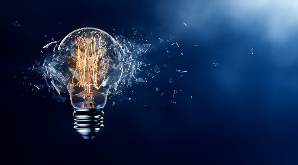 Exploding light bulb on a blue background